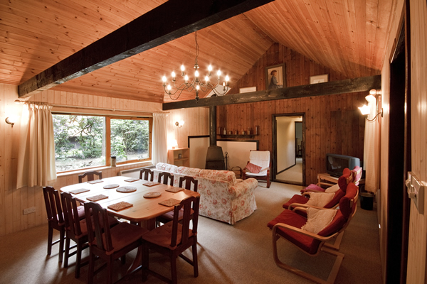 Living area at Rose Cottage log cabin near the New Forest